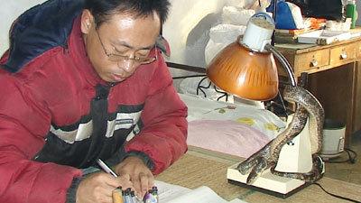 Yu Feng и его змея LongLong